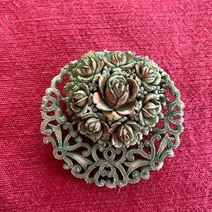 Vintage green celluloid floral brooch